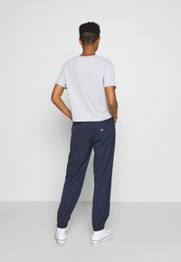 Tommy Jeans - JOGGER TAPE RELAXED - Tracksuit bottoms - twilight navy - 2