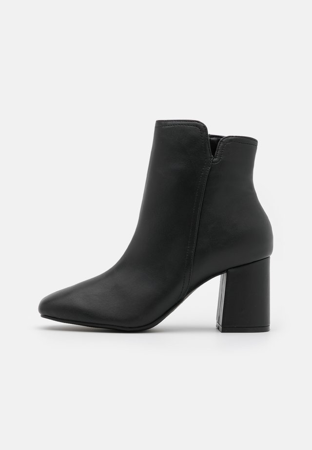 ANNALYNNE - Classic ankle boots - black