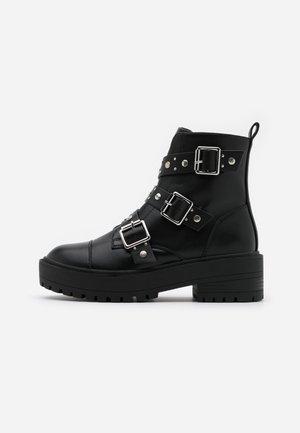 ONLBRANDY-3 BUCKLE - Cowboy/biker ankle boot - black