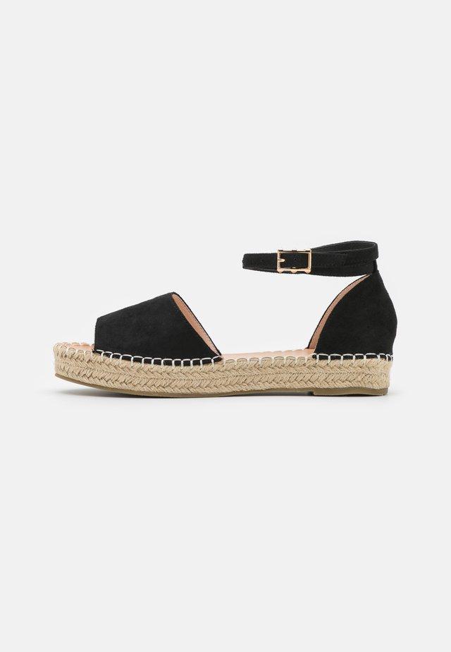 KAIRA - Sandaalit nilkkaremmillä - black