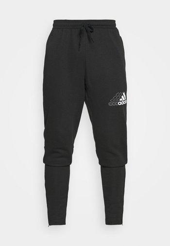 BLUV SERE ESSENTIALS - Pantaloni sportivi - black