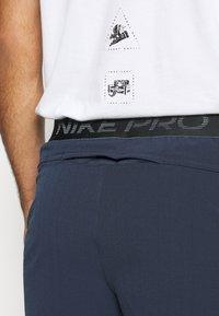 Nike Performance - FLEX - Pantalón corto de deporte - obsidian/black - 5