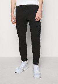C.P. Company - PANTS - Cargo trousers - black - 0