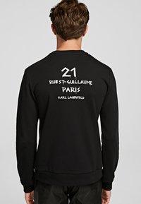 KARL LAGERFELD - GRAFFITI - Sweatshirt - black - 1