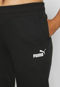 Puma - Tracksuit bottoms - black - 4