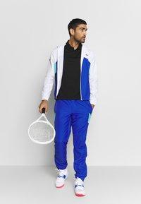 Lacoste Sport - TENNIS - Sports shirt - black/cosmic white - 1
