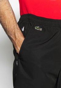 Lacoste Sport - TENNIS PANT TAPERED - Spodnie treningowe - black - 4