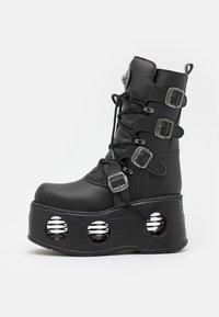 UNISEX - Lace-up boots - black