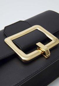 Bally - JANELLE MINI BAG - Across body bag - black/yellow gold-coloured - 5