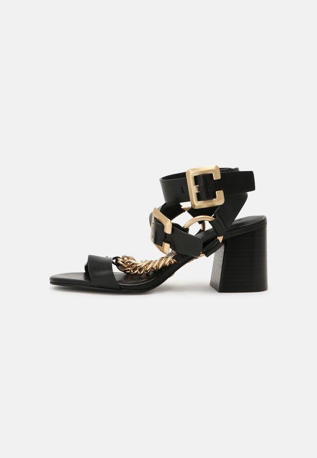 JAGG-ER - Sandaalit nilkkaremmillä - black