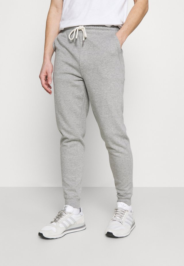 TRIPPY TRACKIE - Tracksuit bottoms - peached grey marle