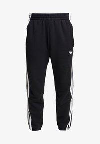 adidas Originals - STRIPE PANEL - Tracksuit bottoms - black/white - 3