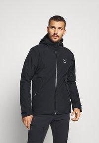 Haglöfs - SKUTA JACKET MEN - Hardshell jacket - true black - 0