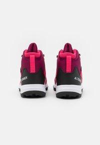 adidas Performance - TERREX MID GTX UNISEX - Hiking shoes - power berry/core black - 2