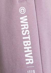 WRSTBHVR - PANTS UNISEX - Träningsbyxor - lilac - 2