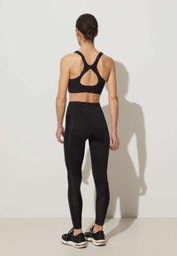 OYSHO - High support sports bra - black - 2
