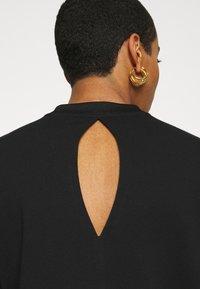 Calvin Klein Jeans - CUT OUT BACK  - Sweatshirt - black - 5