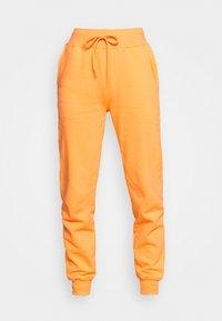WOMENS ESSENTIAL - Tracksuit bottoms - orange