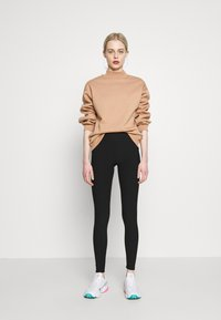 New Look - CROSS WAIST - Leggings - Trousers - black - 1