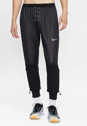 SWIFT SHIELD - Tracksuit bottoms - schwarz