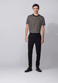BOSS - LAMONT 29_HB - Pantaloni sportivi - black - 1