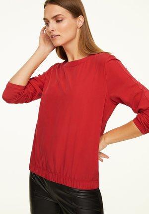 Long sleeved top - scarlet red