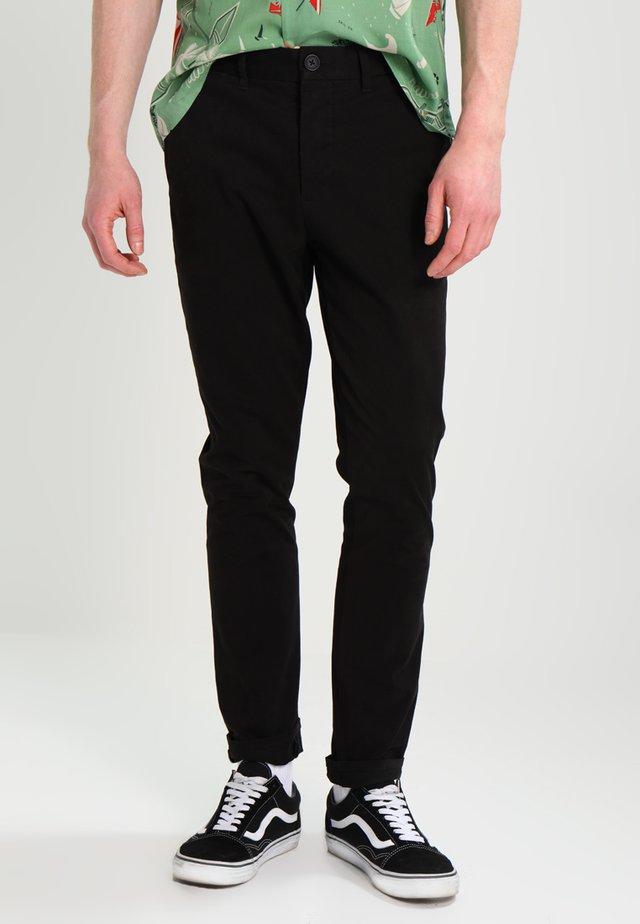 PARK - Chino kalhoty - black