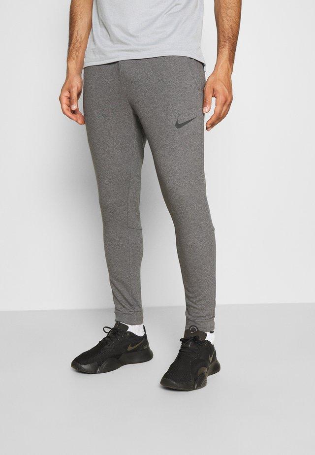 PANT TAPER - Pantalon de survêtement - charcoal heather/black
