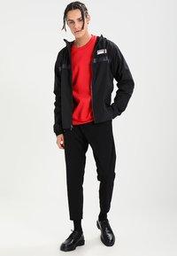 New Balance - ATHLETICS - Summer jacket - black - 1