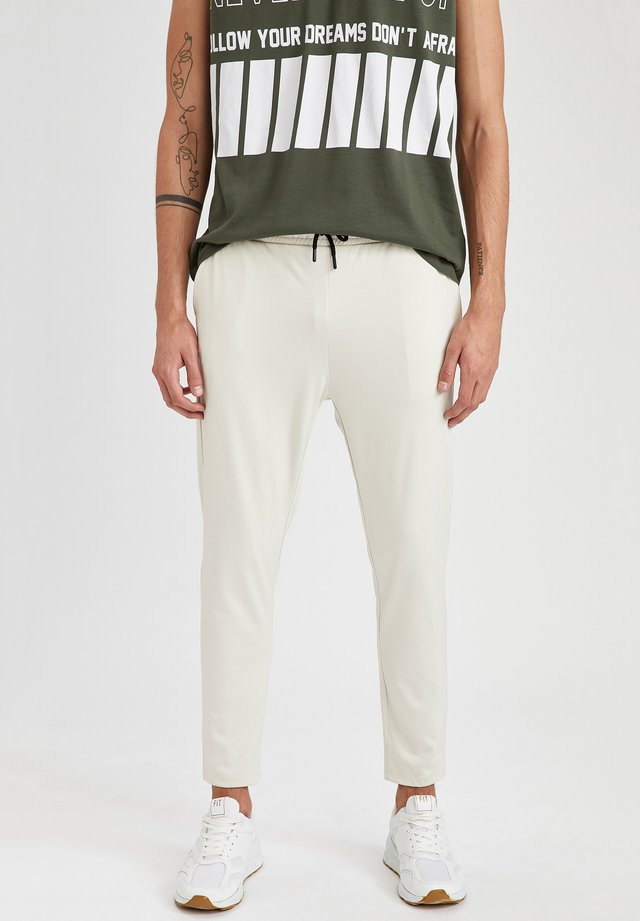 SLIM FIT  - Pantaloni sportivi - beige