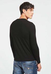 Guess - Long sleeved top - schwarz - 2