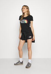 The North Face - RAINBOW SHORT - Sports shorts - black graphic - 1
