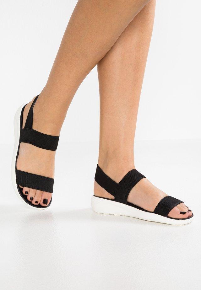LITERIDE - Sandaalit nilkkaremmillä - black/white