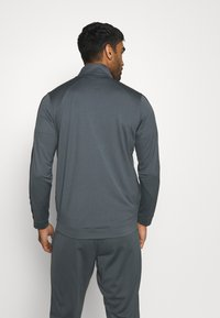Under Armour - EMEA TRACK SUIT - Träningsset - pitch gray/black - 2