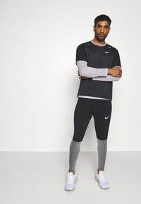 Nike Performance - ELITE - Pantalones deportivos - black/reflective silver - 1