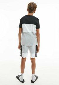 Calvin Klein Jeans - Print T-shirt - ck black - 2