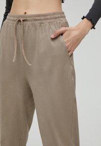 PULL&BEAR - Tracksuit bottoms - beige - 4