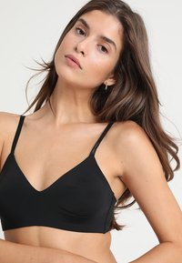 Calvin Klein Underwear - UNLINED  - Triangle bra - black