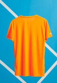 Superdry - T-Shirt print - bright havana orange - 1