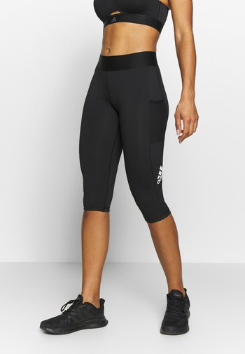 CAPRI - 3/4 sports trousers - black/white