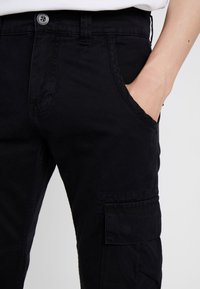 Alpha Industries - Cargo trousers - black - 6