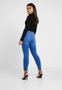 River Island Petite - MOLLY SLEIGH - Jeans Skinny Fit - mid auth - 2