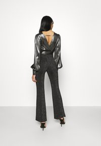 ONLY - ONLPAIGE FLARED GLITTER PANT - Trousers - black - 2
