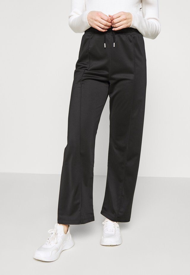 SLIM STRAIGHT - Tracksuit bottoms - black