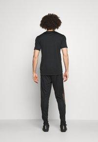 adidas Performance - TIRO PRIDE - Pantaloni sportivi - black - 2