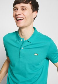 Lacoste LIVE - PH8004 - Polo shirt - niagara blue - 4