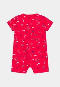 Nike Sportswear - PRINTED ROMPER UNISEX - Overal - university red - 1