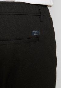 s.Oliver - Tracksuit bottoms - black - 5