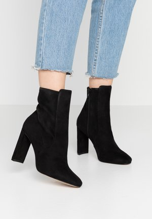 AURELLANE - High heeled ankle boots - black
