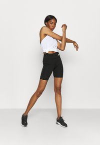Ellesse - KAFFION SHORT - Leggings - black - 1